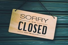 Sorry we are closed sign hang on door. A Sign board of sorry we are closed hang on door of business shop background stock photos