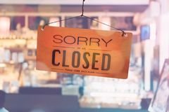 Sorry we are closed sign hang on door. Sorry we are closed sign hang on door at coffee shop stock photo