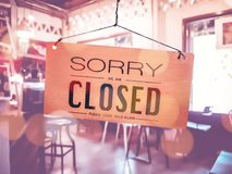 Sorry we are closed sign hang on door. Sorry we are closed sign hang on door at coffee shop royalty free stock photo