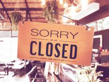 Sorry we are closed sign hang on door. Sorry we are closed sign hang on door at coffee shop royalty free stock photography