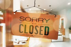 Sorry we are closed sign hang on door. Sorry we are closed sign hang on door at coffee shop royalty free stock images