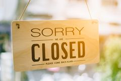Sorry we are closed sign hang on door. Sorry we are closed sign hang on door at coffee shop royalty free stock image