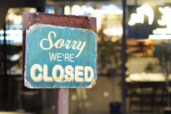 Sorry we are closed sign hanging outside a restaurant, store, office or other royalty free stock image
