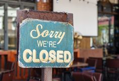 Sorry we are closed sign hanging outside a restaurant, store, office or other royalty free stock photos