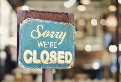 Sorry we are closed sign hanging outside a restaurant, store, office or other royalty free stock photo