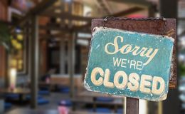 Sorry we are closed sign hanging outside a restaurant, store, office or other stock photos
