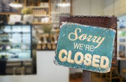 Sorry we are closed sign hanging outside a restaurant, store,. Office or other stock photo