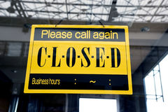 Sorry we are closed sign hanging on a window door outside a restaurant, store Stock Photos