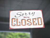 Sorry we are closed sign. On the window Stock Photos