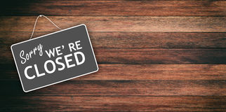 Sorry we are closed sign on wooden background. Sorry we are closed sign hanging on wooden background stock image