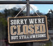 Sorry We Are Closed But Still Awesome Sign. Sorry We Are Closed But Still Awesome Vintage Business Sign stock photo