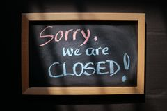 Sorry we are closed written on a board stock image