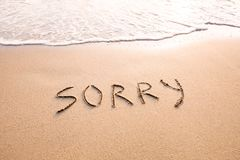Sorry concept, excuse and  apologize. Sorry concept written on the sand, excuse and  apologise Stock Image