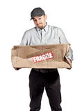 So sorry. Delivery man and broken parcel royalty free stock image