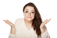 Sorry gesture. Young woman with a sorry gesture on white background Royalty Free Stock Photo