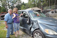 Wrecked car. Senior men upset his car is wrecked by granddaughter stock image