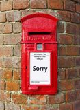 Sorry greeting card design. British post box with a message that reads Sorry, ideal for a greeting card design stock photo