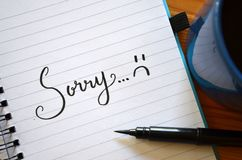 SORRY hand-lettered in notebook royalty free stock photos