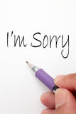 Sorry hand write writing. I am sorry hand write writing writing note note Royalty Free Stock Images