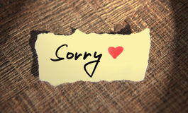 Sorry handwritten. On the piece of paper Stock Images