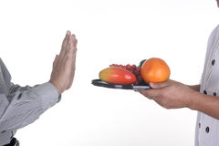 Sorry I don't like Fruit. / Chef present fruit to customer in Chef concept isolate on white royalty free stock photo