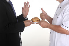 Sorry I hate Junk food. Chef present Hamburger to customer in Chef concept isolate on white Royalty Free Stock Photo