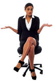 Sorry, I have no idea!. Isolated corporate lady in office. She has no idea at all Royalty Free Stock Image