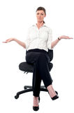 Sorry, I have no idea!. Sullen faced corporate lady sitting on the chair royalty free stock images