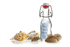 Sorry, I need a vacation, message in a bottle made of glass bet. Sorry, I need a vacation, message in a bottle of glass between some sea shells isolated on a stock images