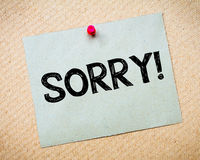 Sorry Message. Recycled paper note pinned on cork board.Sorry Message. Concept Image stock photo