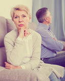 Sorry middle-aged couple quarreling at home with each other. And take offense stock photos