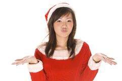 Sorry No Gifts. A cute asian woman dressed as santa shrugs her shoulders stock photo