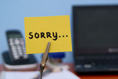 Sorry note. The word sorry written on a memo in a office Royalty Free Stock Photography