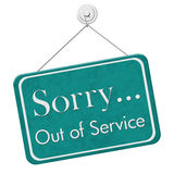 Sorry Out of Service Sign. Sorry Out of Service,  A teal and white sign with the words Sorry Out of Service isolated on a white background Stock Photography