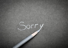 Sorry. A piece of paper with the words I'm sorry Stock Image