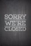 Sorry we're closed on blackboard. Sorry we're closed on black blackboard stock photo