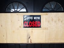 Sorry we `re closed sign on door and wooden board royalty free stock photo
