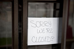 Sorry We're Closed. A sorry we're closed sign hanging at a food stop that was flooded Stock Photos