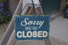Sorry We're Closed. Closed Sign hanging outside a cafe Royalty Free Stock Image