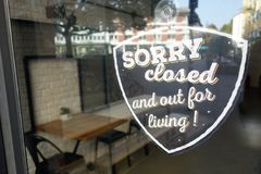 Sorry, we`re closed sign. On urban restaurant door Royalty Free Stock Photos