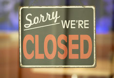 Sorry We`re Closed Sign in Window. Close Up of Closed Sign Hanging in Window Stock Images