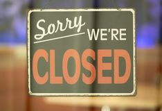 Sorry We`re Closed Sign in Window. Close Up of Closed Sign Hanging in Window Royalty Free Stock Image
