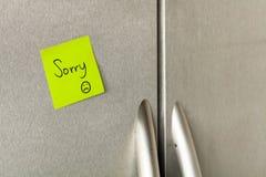 Sorry refrigerator note. Sorry sticky note on a home refrigerator Stock Photo