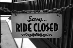 Sorry. Ride Closed. A closed sign is posted outside of a theme park ride Royalty Free Stock Image