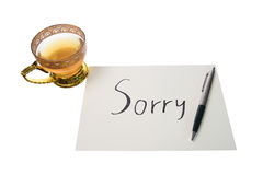 Sorry. Say sorry with a text message on paper and pen Royalty Free Stock Images