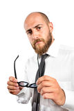 We are sorry to say... Boss holding glasses with sad look during job interview royalty free stock photos