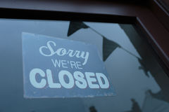 Sorry Were Closed Sign. Sign in a store window that says Sorry Were Closed Royalty Free Stock Photo
