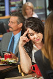 Sorry Woman. Sorry female sitting with friend in coffee house stock images