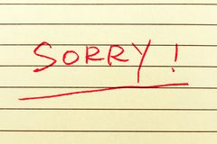 Sorry word. Written on the paper Royalty Free Stock Image