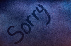 Sorry word draw. On fogged window background. Sorry on wet frozen glass texture Royalty Free Stock Photos